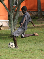 chasing the ball Bugala Island, East Africa, Uganda, Africa